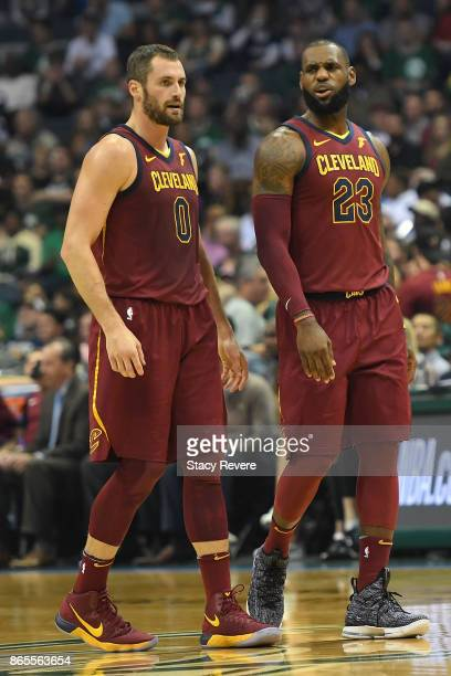 Kevin Love and LeBron James of the Cleveland Cavaliers walk backcourt during a game against the Milwaukee Bucks at the Bradley Center on October 20...