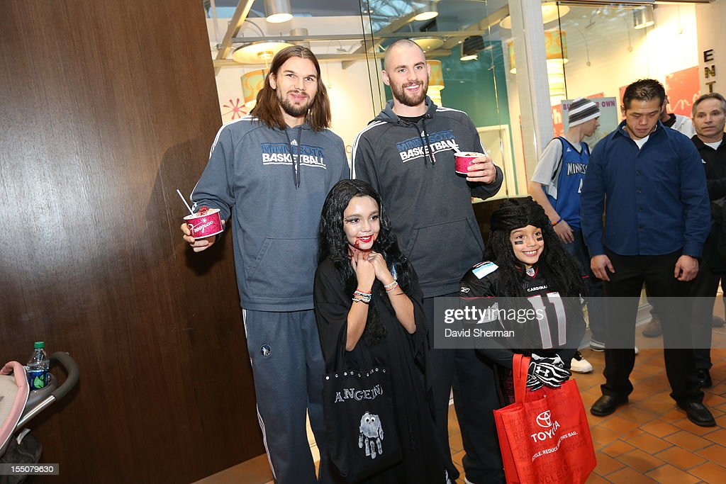 Kevin Love and Lou Amundson of the Minnesota Timberwolves pose for a photograph stops after trick or treating with kids who have cancer or other life-threatening illness, from Hope Kids, and their families on October 31, 2012 at the Mall of America in Bloomington, Minnesota.