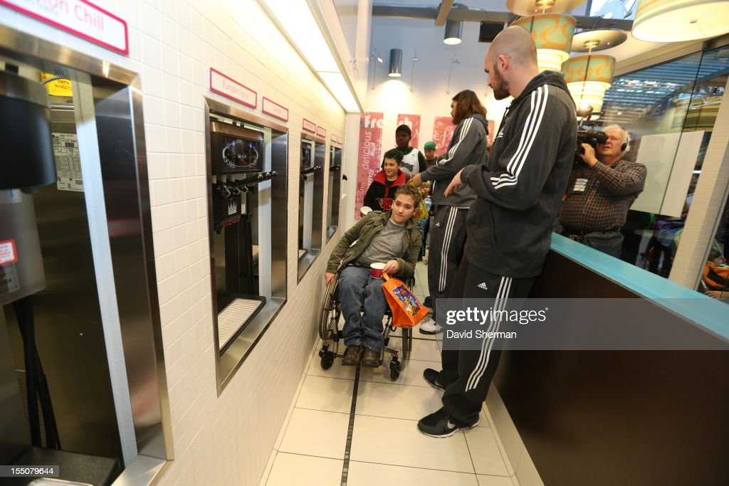 Kevin Love and Lou Amundson of the Minnesota Timberwolves stop for frozen yogurt after trick or treating with kids who have cancer or other life-threatening illness, from Hope Kids, and their families on October 31, 2012 at the Mall of America in Bloomington, Minnesota.