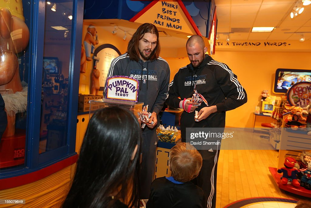 Kevin Love and Lou Amundson of the Minnesota Timberwolves trick or treat with kids who have cancer or other life-threatening illness, from Hope Kids, and their families on October 31, 2012 at the Mall of America in Bloomington, Minnesota.