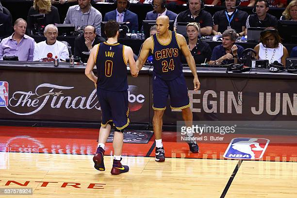 Kevin Love and Richard Jefferson of the Cleveland Cavaliers shake hands during Game Six of the NBA Eastern Conference Finals against the Toronto...