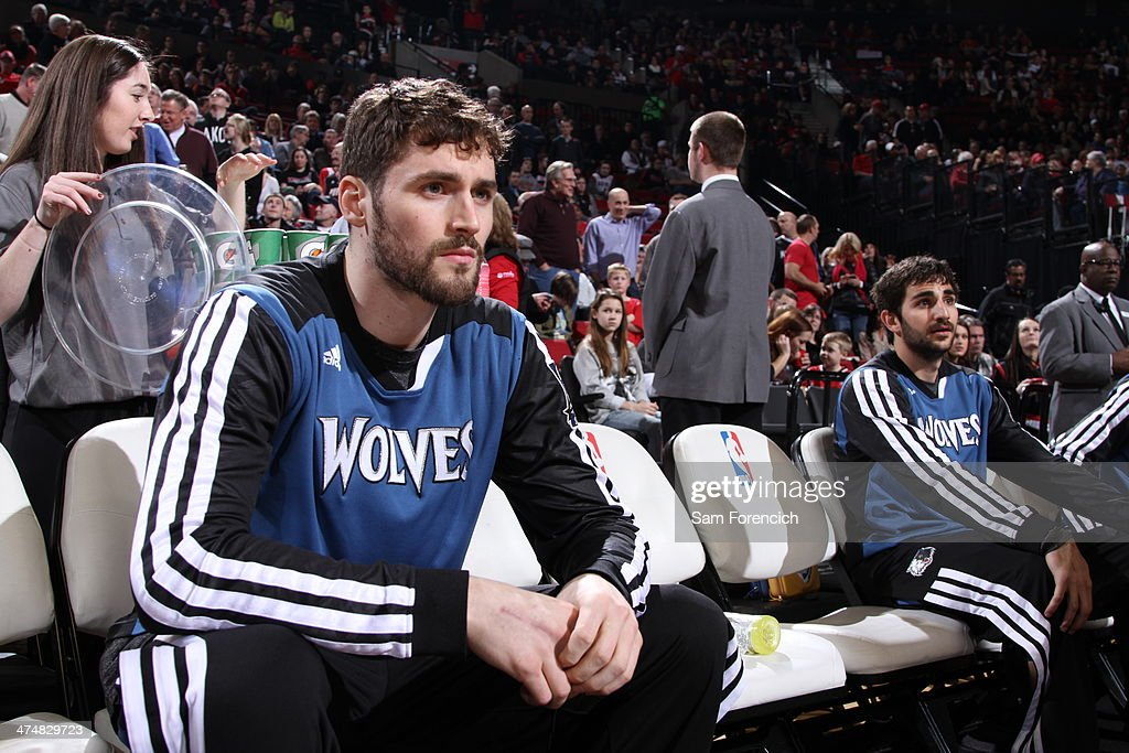Kevin Love #42 and Ricky Rubio #9 of the Minnesota Timberwolves sit on the bench during the game against the Portland Trail Blazers on February 23, 2014 at the Moda Center Arena in Portland, Oregon.