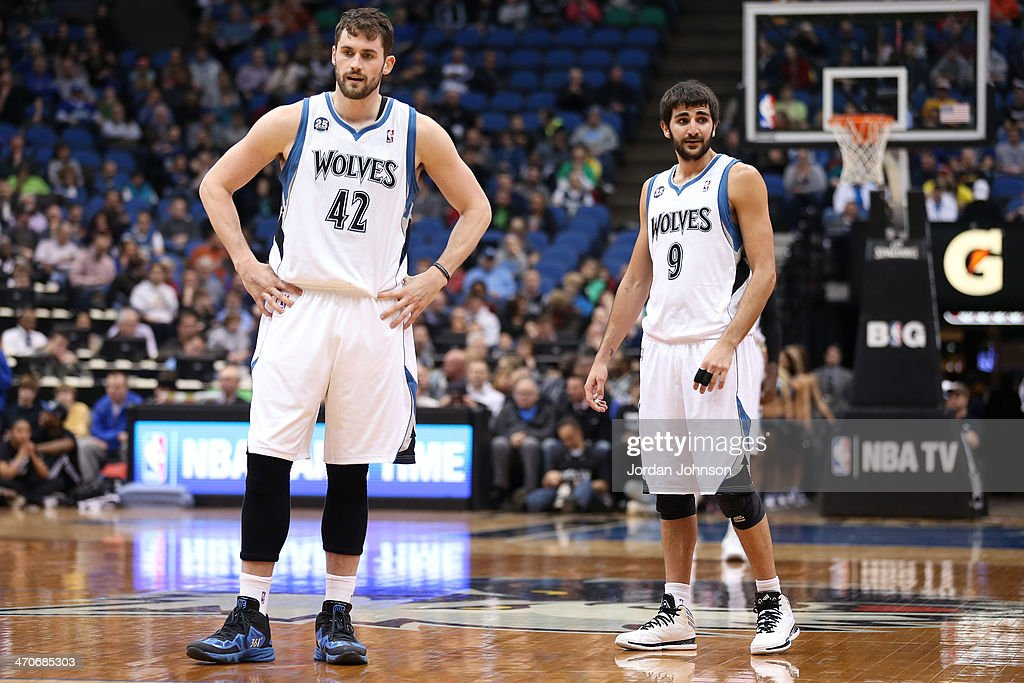 <a gi-track='captionPersonalityLinkClicked' href=/galleries/search?phrase=Kevin+Love&family=editorial&specificpeople=4212726 ng-click='$event.stopPropagation()'>Kevin Love</a> #42 and <a gi-track='captionPersonalityLinkClicked' href=/galleries/search?phrase=Ricky+Rubio&family=editorial&specificpeople=4028920 ng-click='$event.stopPropagation()'>Ricky Rubio</a> #9 of the Minnesota Timberwolves stand on the court against the Indiana Pacers on February 19, 2014 at Target Center in Minneapolis, Minnesota.