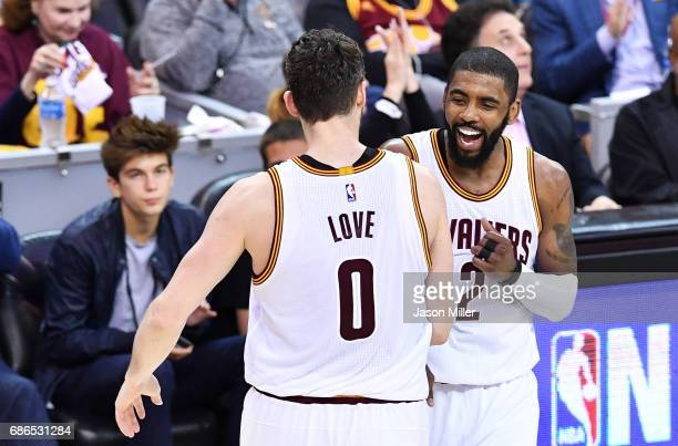 Kevin Love celebrates with Kyrie Irving of the Cleveland Cavaliers in the second quarter against the Boston Celtics during Game Three of the 2017 NBA...