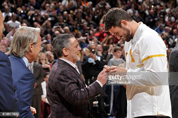 Kevin Love gets his championship ring presented to him by Dan Gilbert Owner of the Cleveland Cavaliers before the game against the New York Knicks on...