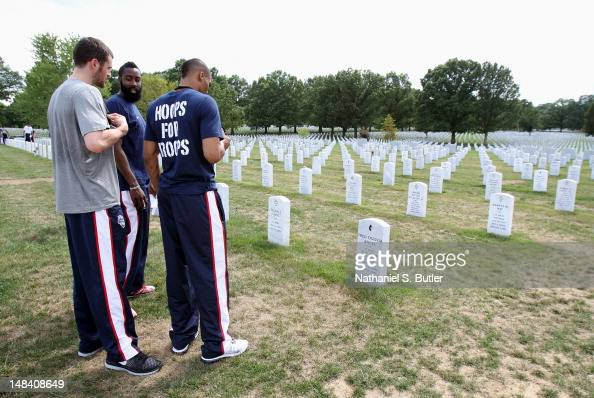 Kevin Love James Harden and Russell Westbrook of the 2012 US Men's Senior National Team during a visit to Arlington National Cemetery on July 15 2012...