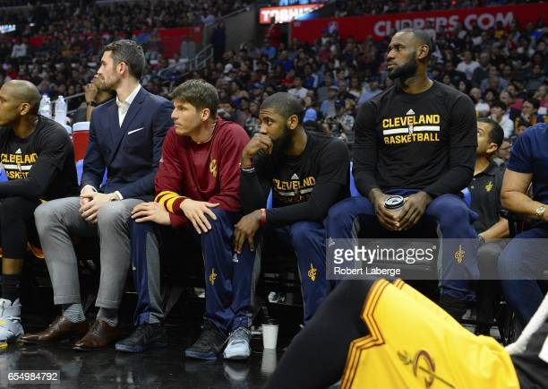 Kevin Love Kyle Korver Kyrie Irving and Lebron James of the Cleveland Cavaliers sitting out the game against the Los Angeles Clippers on March 18...