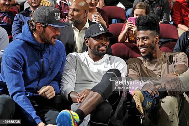 Kevin Love Kyrie Irving and Iman Shumpert of the Cleveland Cavaliers sit on th bench during a scrimmage at The Quicken Loans Arena on October 5 2015...