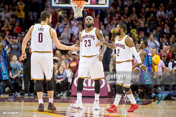 Kevin Love LeBron James and Kyrie Irving of the Cleveland Cavaliers celebrate after a play during the first half against the Charlotte Hornets at...