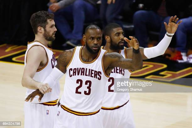Kevin Love LeBron James and Kyrie Irving of the Cleveland Cavaliers react after a play in the first quarter against the Golden State Warriors in Game...