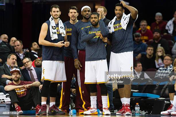Kevin Love Mike Miller LeBron James Kyrie Irving and Tristan Thompson of the Cleveland Cavaliers watch from the bench during the second half against...