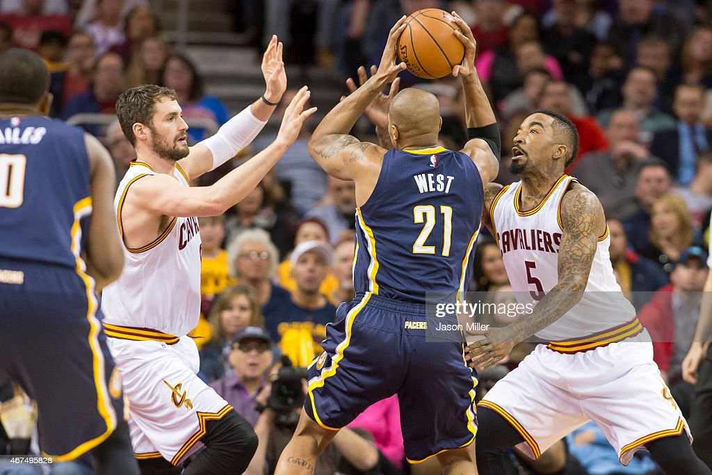 Kevin Love of the Cleveland Cavaliers and JR Smith guard David West of the Indiana Pacers during the first half at Quicken Loans Arena on March 20...