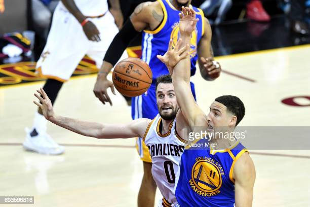 Kevin Love of the Cleveland Cavaliers and Klay Thompson of the Golden State Warriors compete for the ball in the first half in Game 3 of the 2017 NBA...