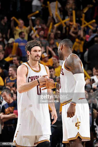 Kevin Love of the Cleveland Cavaliers and LeBron James of the Cleveland Cavaliers celebrate and shake hands after the game against the Indiana Pacers...