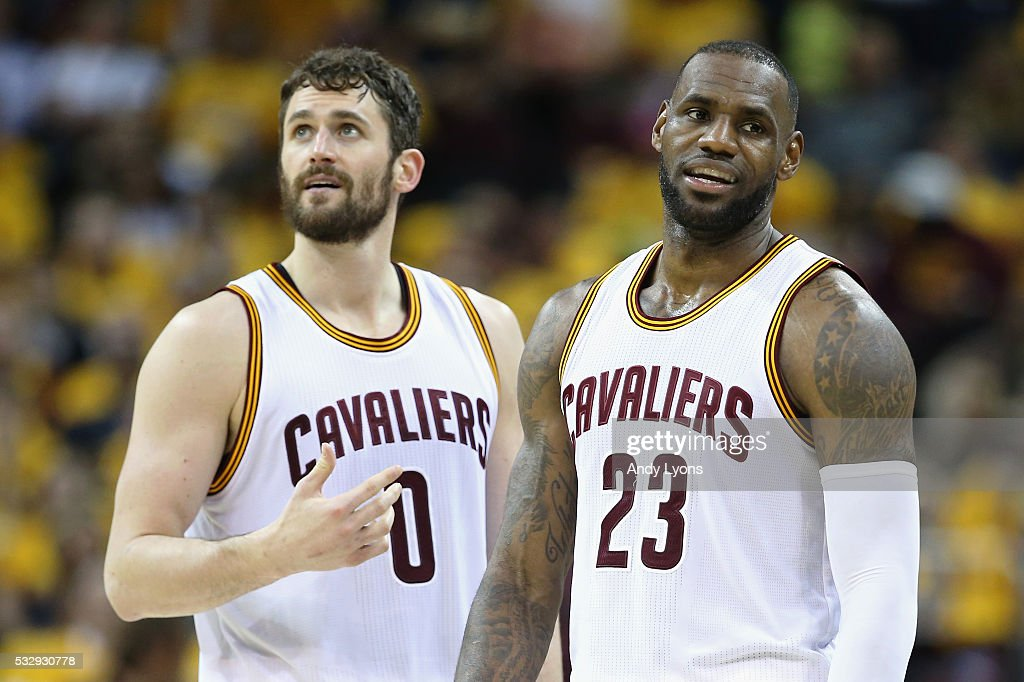 Kevin Love #0 of the Cleveland Cavaliers and LeBron James #23 react during the second half against the Toronto Raptors in game two of the Eastern Conference Finals during the 2016 NBA Playoffs at Quicken Loans Arena on May 19, 2016 in Cleveland, Ohio.