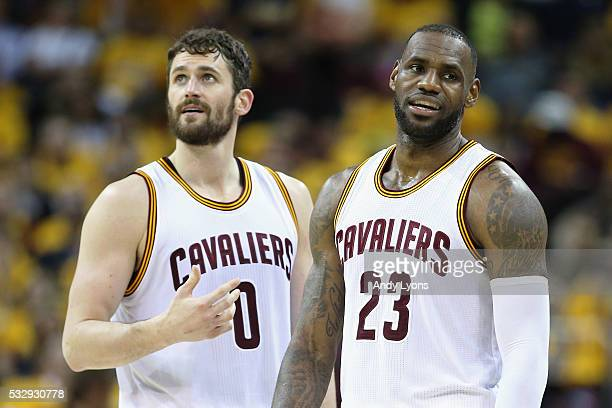 Kevin Love of the Cleveland Cavaliers and LeBron James react during the second half against the Toronto Raptors in game two of the Eastern Conference...