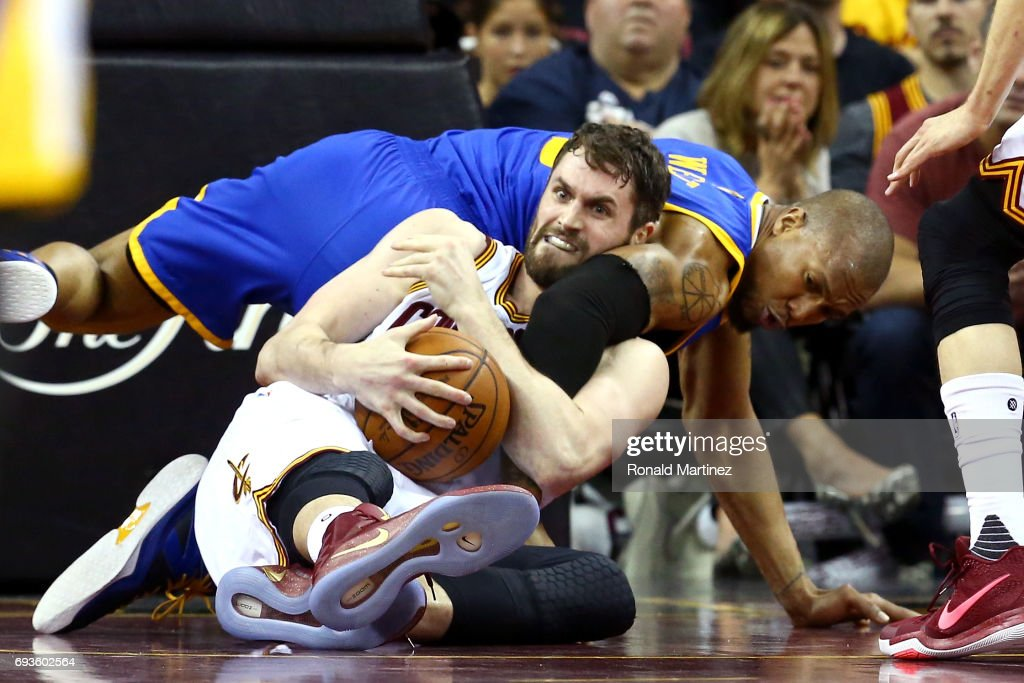 Kevin Love #0 of the Cleveland Cavaliers competes for the ball with David West #3 of the Golden State Warriors in the second half in Game 3 of the 2017 NBA Finals at Quicken Loans Arena on June 7, 2017 in Cleveland, Ohio.