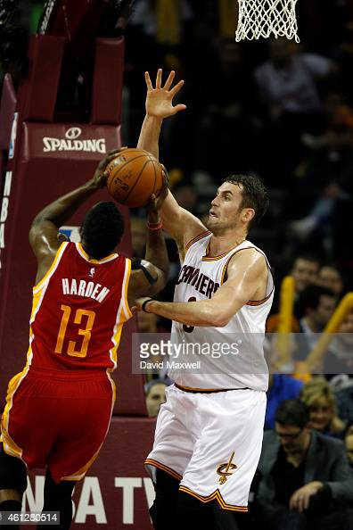 Kevin Love of the Cleveland Cavaliers defends against James Harden of the Houston Rockets during the second half of their game on January 7 2015 at...