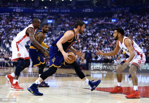Kevin Love of the Cleveland Cavaliers dribbles the ball as Cory Joseph of the Toronto Raptors defends in the first half of Game Four of the Eastern...