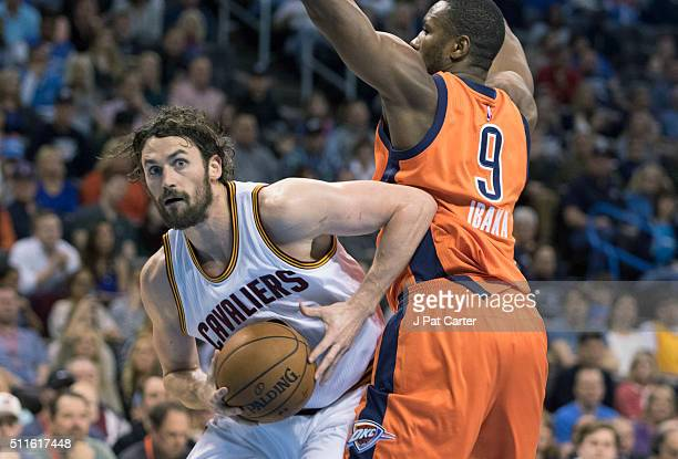 Kevin Love of the Cleveland Cavaliers drives around Serge Ibaka of the Oklahoma City Thunder as he looks for a play during the first quarter of a NBA...
