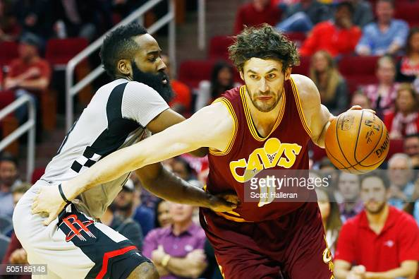 Kevin Love of the Cleveland Cavaliers drives with the ball in front of James Harden of the Houston Rockets during their game at the Toyota Center on...