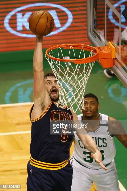 Kevin Love of the Cleveland Cavaliers dunks the ball in the first half against the Boston Celtics during Game One of the 2017 NBA Eastern Conference...