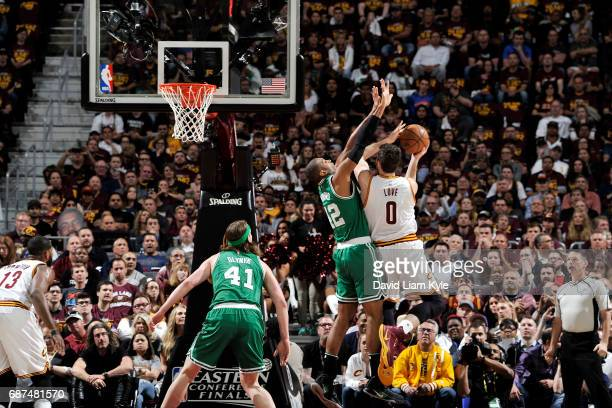 Kevin Love of the Cleveland Cavaliers goes for a lay up during the game against Al Horford of the Boston Celtics in Game Four of the Eastern...