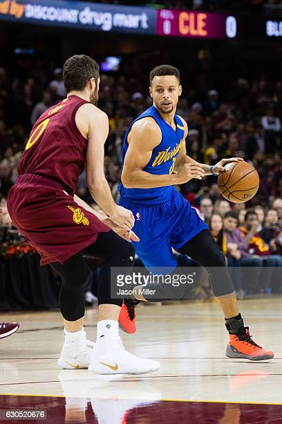 Kevin Love of the Cleveland Cavaliers guards Stephen Curry of the Golden State Warriors during the first half at Quicken Loans Arena on December 25...