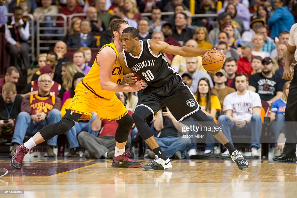 Kevin Love of the Cleveland Cavaliers guards Thaddeus Young of the Brooklyn Nets during the first half at Quicken Loans Arena on March 18 2015 in...