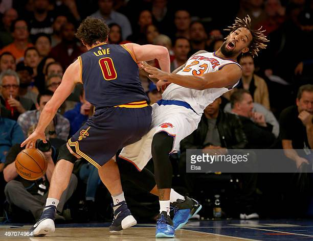 Kevin Love of the Cleveland Cavaliers is called for an offensive foul as he collides with Derrick Williams of the New York Knicks at Madison Square...