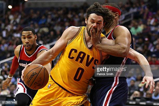 Kevin Love of the Cleveland Cavaliers is fouled by Jared Dudley of the Washington Wizards during the first half at Verizon Center on February 28 2016...
