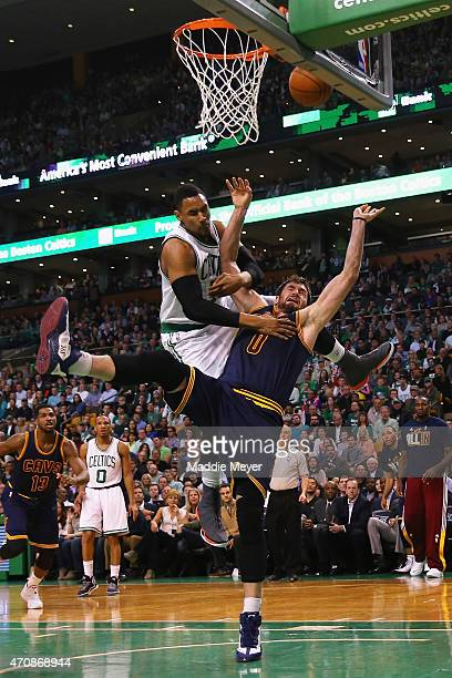 Kevin Love of the Cleveland Cavaliers is fouled by Jared Sullinger of the Boston Celtics during the first quarter of their game in the first round of...