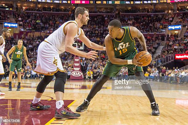Kevin Love of the Cleveland Cavaliers puts pressure on Derrick Favors of the Utah Jazz during the first half at Quicken Loans Arena on January 21...