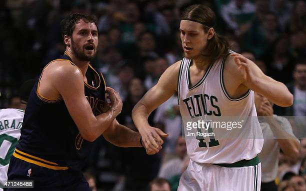 Kevin Love of the Cleveland Cavaliers reacts after an injury against the Boston Celtics in the first quarter in Game Four during the first round of...