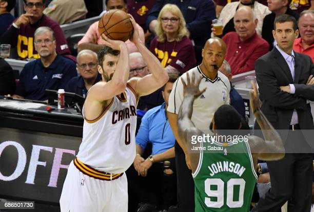 Kevin Love of the Cleveland Cavaliers shoots against Amir Johnson of the Boston Celtics in the first half during Game Three of the 2017 NBA Eastern...