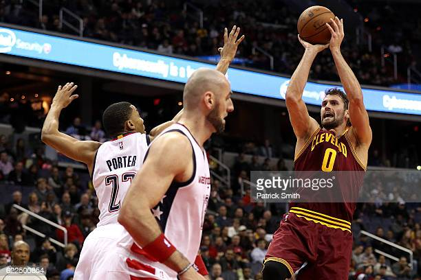 Kevin Love of the Cleveland Cavaliers shoots in front of Otto Porter Jr #22 of the Washington Wizards during the first half at Verizon Center on...