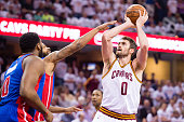 Kevin Love of the Cleveland Cavaliers shoots over Marcus Morris of the Detroit Pistons during the first half of the NBA Eastern Conference...