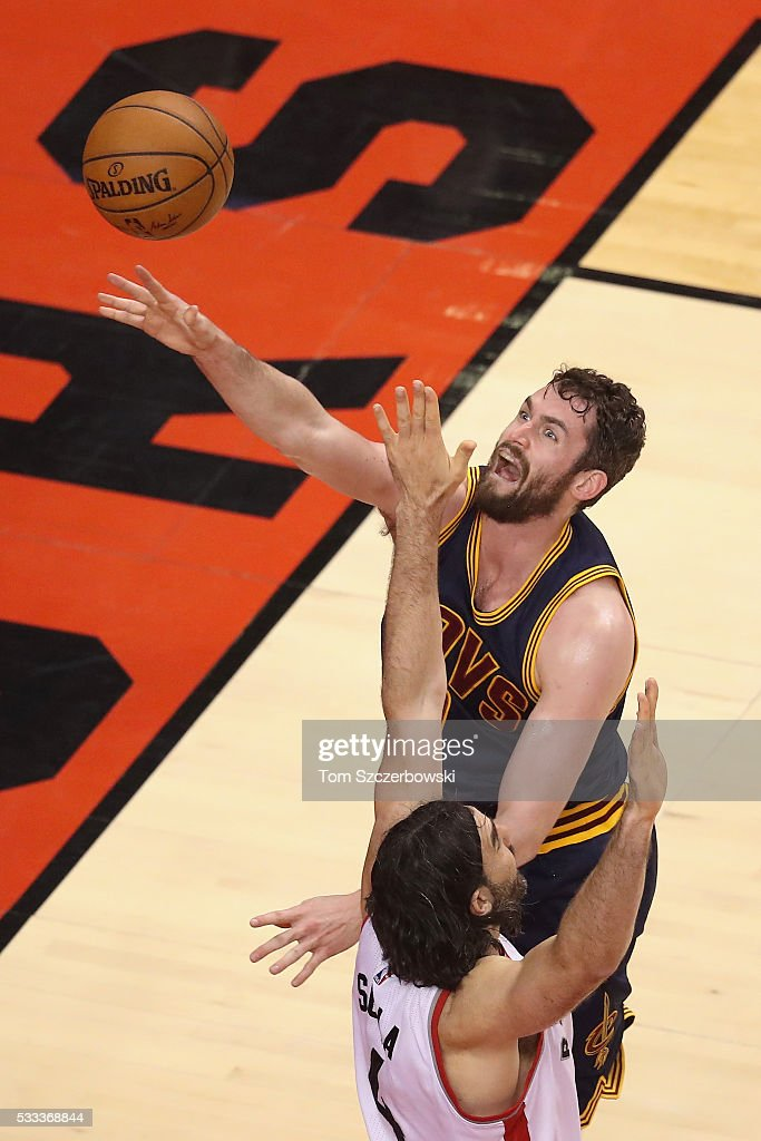<a gi-track='captionPersonalityLinkClicked' href=/galleries/search?phrase=Kevin+Love&family=editorial&specificpeople=4212726 ng-click='$event.stopPropagation()'>Kevin Love</a> #0 of the Cleveland Cavaliers shoots the ball against <a gi-track='captionPersonalityLinkClicked' href=/galleries/search?phrase=Luis+Scola&family=editorial&specificpeople=2464749 ng-click='$event.stopPropagation()'>Luis Scola</a> #4 of the Toronto Raptors during the second half in game three of the Eastern Conference Finals during the 2016 NBA Playoffs at Air Canada Centre on May 21, 2016 in Toronto, Canada.