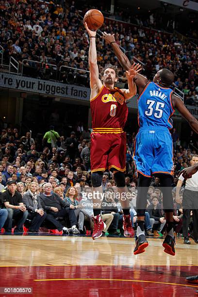 Kevin Love of the Cleveland Cavaliers shoots the ball against the Oklahoma City Thunder on December 17 2015 at Quicken Loans Arena in Cleveland Ohio...