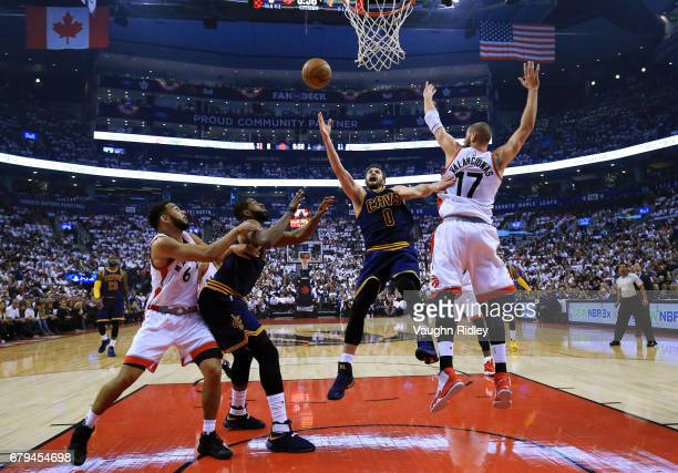 Kevin Love of the Cleveland Cavaliers shoots the ball as Jonas Valanciunas of the Toronto Raptors defends in the first half of Game Three of the...