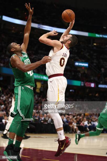 Kevin Love of the Cleveland Cavaliers takes a shot over Al Horford of the Boston Celtics at Quicken Loans Arena on October 17 2017 in Cleveland Ohio...