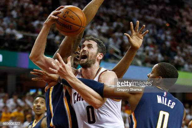 Kevin Love of the Cleveland Cavaliers tries to get a shot off next to CJ Miles of the Indiana Pacers during the second half in Game Two of the...