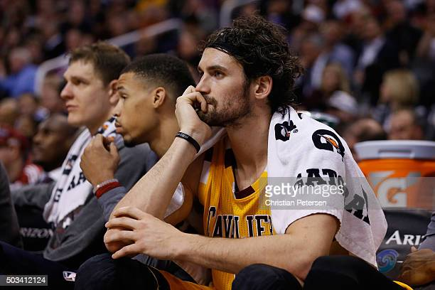 Kevin Love of the Cleveland Cavaliers watches from the bench during the NBA game against the Phoenix Suns at Talking Stick Resort Arena on December...