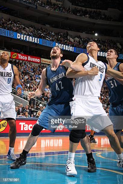 Kevin Love of the Minnesota Timberwolves and Yi Jianlian of the Dallas Mavericks wait for a rebound during the game against the Dallas Mavericks and...