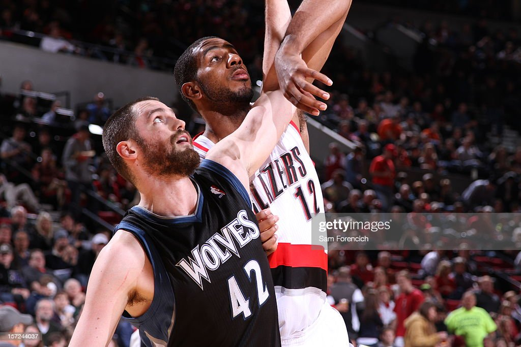 <a gi-track='captionPersonalityLinkClicked' href=/galleries/search?phrase=Kevin+Love&family=editorial&specificpeople=4212726 ng-click='$event.stopPropagation()'>Kevin Love</a> #42 of the Minnesota Timberwolves boxes out <a gi-track='captionPersonalityLinkClicked' href=/galleries/search?phrase=LaMarcus+Aldridge&family=editorial&specificpeople=453277 ng-click='$event.stopPropagation()'>LaMarcus Aldridge</a> #12 of the Portland Trail Blazers on November 23, 2012 at the Rose Garden Arena in Portland, Oregon.