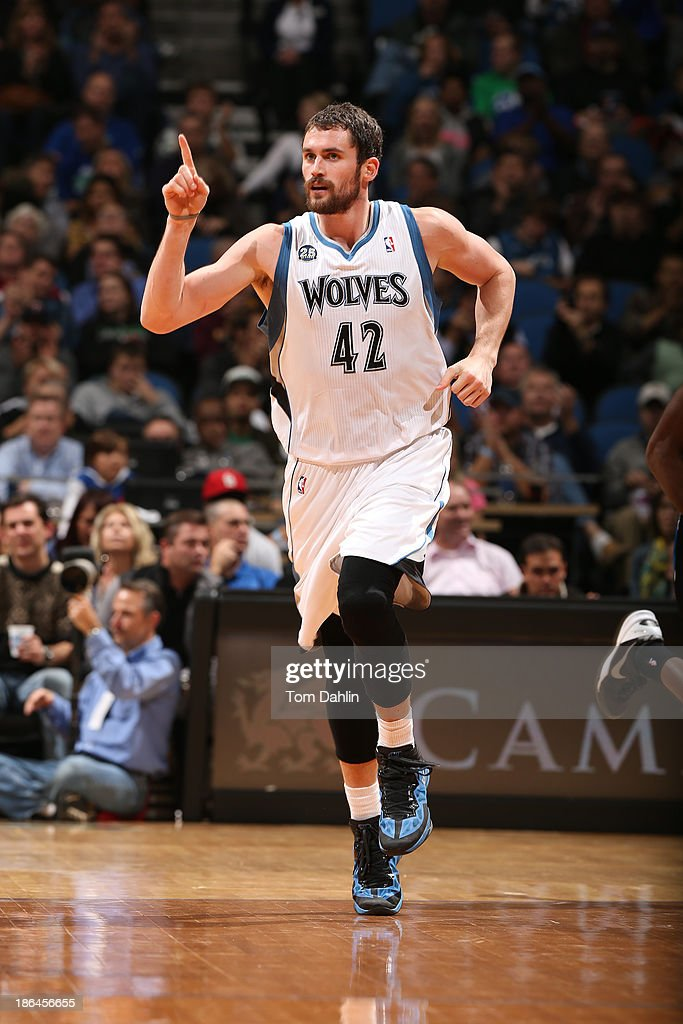 Kevin Love #42 of the Minnesota Timberwolves celebrates a play against the Orlando Magic during the season and home opening game on October 30, 2013 at Target Center in Minneapolis, Minnesota.