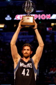 Kevin Love of the Minnesota Timberwolves celebrates with the trophy after he won the Foot Locker ThreePoint Contest part of 2012 NBA AllStar Weekend...