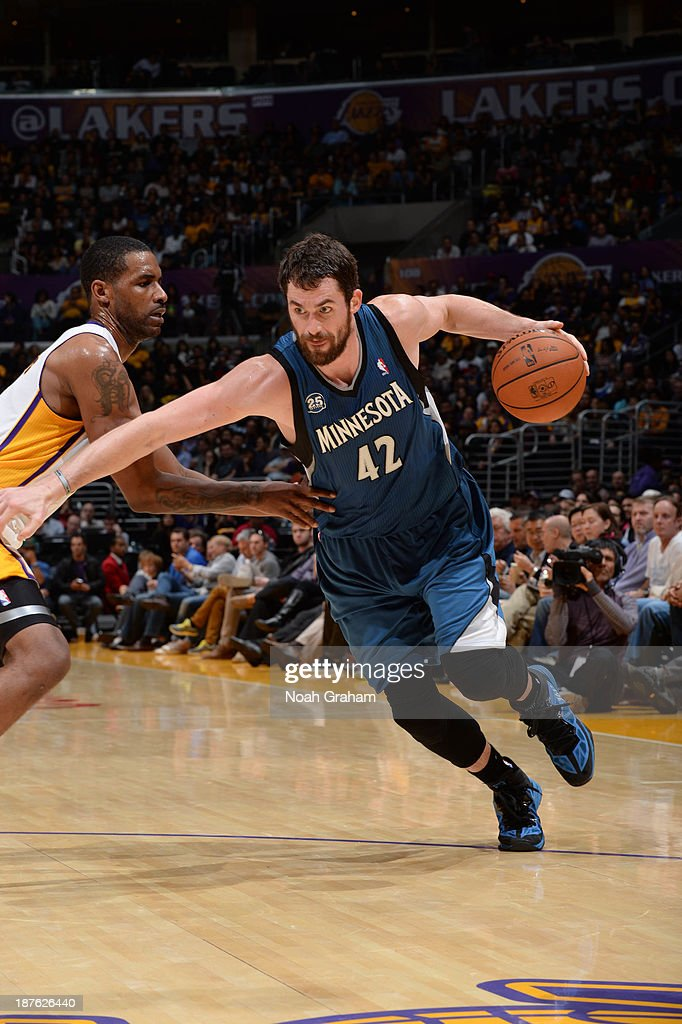 <a gi-track='captionPersonalityLinkClicked' href=/galleries/search?phrase=Kevin+Love&family=editorial&specificpeople=4212726 ng-click='$event.stopPropagation()'>Kevin Love</a> #42 of the Minnesota Timberwolves dribbles against <a gi-track='captionPersonalityLinkClicked' href=/galleries/search?phrase=Shawne+Williams&family=editorial&specificpeople=728608 ng-click='$event.stopPropagation()'>Shawne Williams</a> #3 of the Los Angeles Lakers at Staples Center on November 10, 2013 in Los Angeles, California.