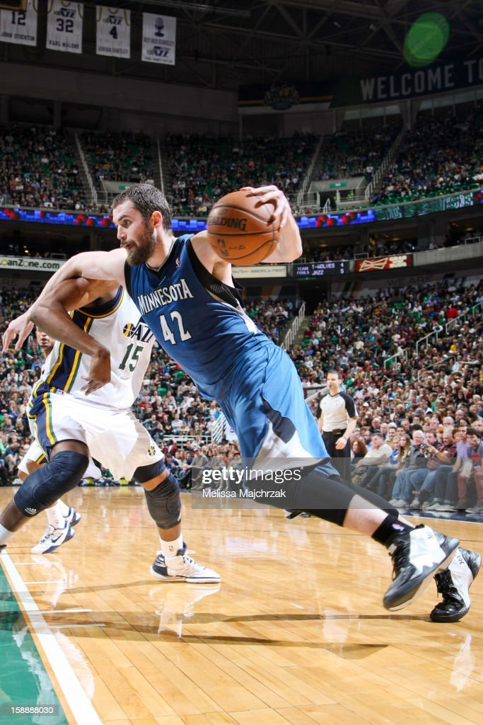 <a gi-track='captionPersonalityLinkClicked' href=/galleries/search?phrase=Kevin+Love&family=editorial&specificpeople=4212726 ng-click='$event.stopPropagation()'>Kevin Love</a> #42 of the Minnesota Timberwolves drives against <a gi-track='captionPersonalityLinkClicked' href=/galleries/search?phrase=Derrick+Favors&family=editorial&specificpeople=5792014 ng-click='$event.stopPropagation()'>Derrick Favors</a> #15 of the Utah Jazz at Energy Solutions Arena on January 2, 2013 in Salt Lake City, Utah.