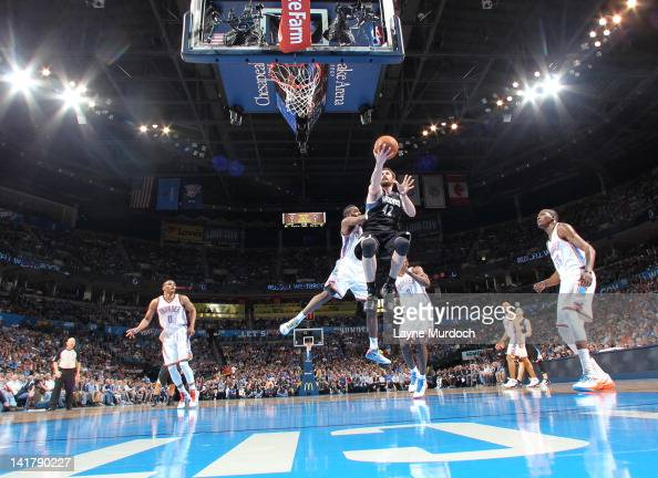 Kevin Love of the Minnesota Timberwolves drives to the basket against James Harden of the Oklahoma City Thunder on March 23 2012 at the Chesapeake...